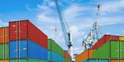 export or import shipping cargo container stacks and port cranes